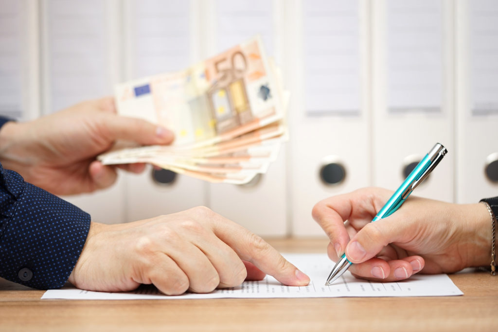 employer or businessman showing where to sign  in exchange